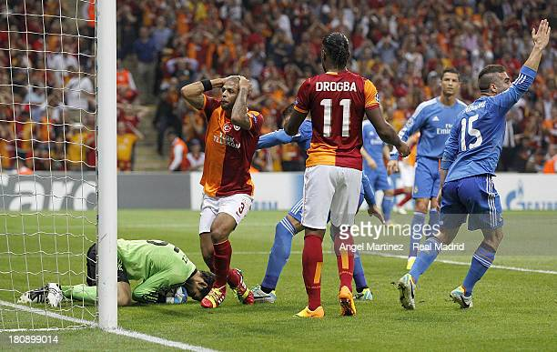 Goalkeeper Diego Lopez of Real Madrid makes a save as Felipe Melo of Galatasaray AS reacts during the UEFA Champions League group B match between...