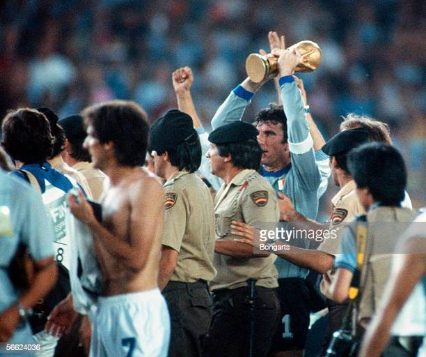 Goalkeeper Dino Zoff of Italy celebrate with trophy and the team after the World Cup final match between Italy and Germany on July 11 1982 in Madrid...