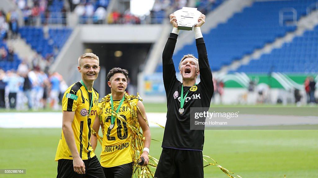 Goalkeeper Dominik Reimann of Dortmund celebrates with the trophy after the A Juniors German Championship Final match between 1899 Hoffenheim U19 and Borussia Dortmund U19 at Wirsol Rhein-Neckar-Arena on May 29, 2016 in Sinsheim, Germany.