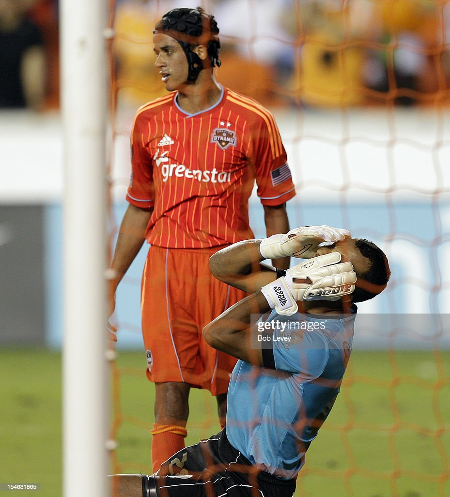 Goalkeeper Donis Escobar of the Olimpia holds head after exchanging shoves with Calen Carr of the Houston Dynamo in the second half at BBVA Compass...