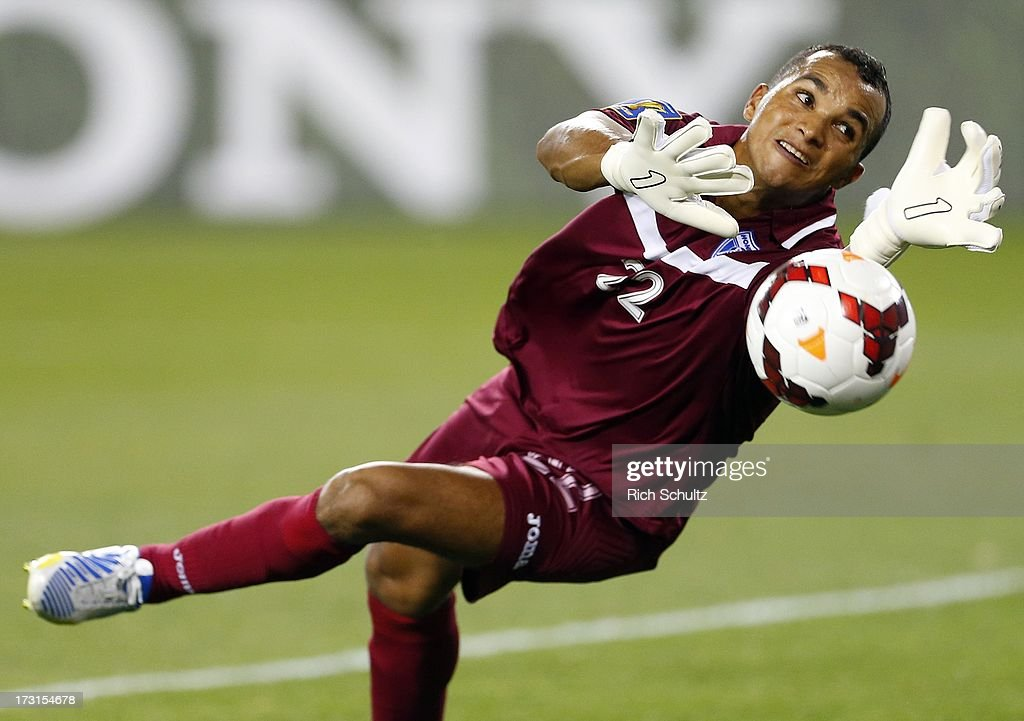 Goalkeeper <a gi-track='captionPersonalityLinkClicked' href=/galleries/search?phrase=Donis+Escober&family=editorial&specificpeople=5962688 ng-click='$event.stopPropagation()'>Donis Escober</a> #22 of Honduras makes a save during the first half against Haiti of a 2013 CONCACAF Gold Cup soccer match on July 8, 2013 at Red Bull Arena in Harrison, New Jersey.