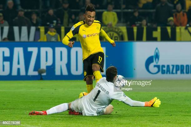 Goalkeeper Ederson of Benfica and PierreEmerick Aubameyang of Borussia Dortmund battle for the ball during the UEFA Champions League Round of 16...