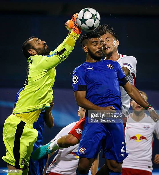 Goalkeeper Eduardo of Dinamo Zagreb and El Arabi Hilal Soudani competes for the ball against Fredrik Gulbrandsen of Salzburg during the UEFA...