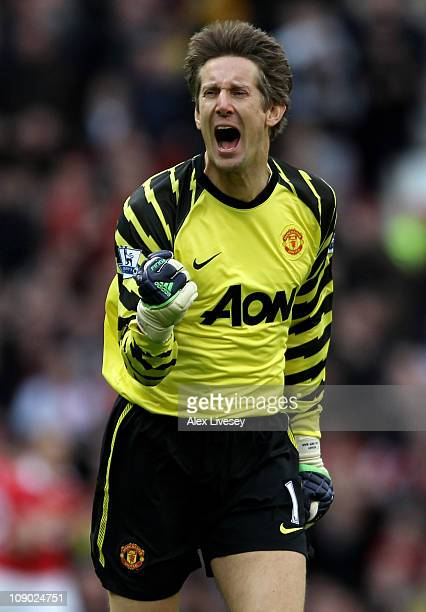 Goalkeeper Edwin van der Sar of Manchester United celebrates as teammate Nani scores the opening goal during the Barclays Premier League match...