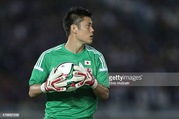 Goalkeeper Eiji Kawashima of Japan looks to throw the ball out during the international friendly match between Japan and Iraq at Nissan Stadium on...