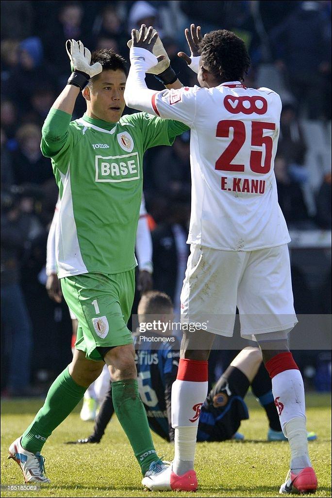 Goalkeeper Eiji Kawashima of Standard celebrates the victory with Antonio Pereira Dos Santos aka Kanu of Standard after the Jupiler League match between Club Brugge and Standard de Liege on April 01, 2013 in the Jan Breydel Stadium in Brugge, Belgium.