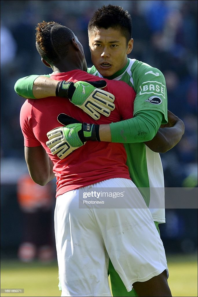goalkeeper Eiji Kawashima of Standard celebrates the victory with Paul-Jose Mpoku of Standard after the Jupiler League match between Club Brugge and Standard de Liege on April 01, 2013 in the Jan Breydel Stadium in Brugge, Belgium.