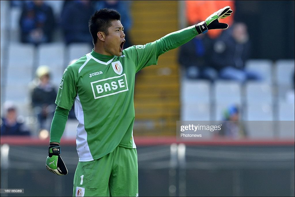 Goalkeeper <a gi-track='captionPersonalityLinkClicked' href=/galleries/search?phrase=Eiji+Kawashima&family=editorial&specificpeople=3117136 ng-click='$event.stopPropagation()'>Eiji Kawashima</a> of Standard shouts during the Jupiler League match between Club Brugge and Standard de Liege on April 01, 2013 in the Jan Breydel Stadium in Brugge, Belgium.