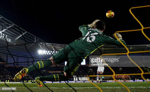 Goalkeeper Eldin Jakupovic of Hull City dives as Dwight Gayle of Newcastle United misses in the penalty shoot out after the EFL Cup QuarterFinal...