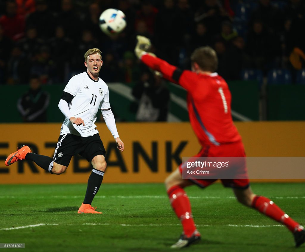 Goalkeeper Elias Rasmussen of Faroe Islands saves a shot from Julian Brandt of Germany during the 2017 UEFA European U21 Championships qualifier...