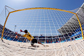 Goalkeeper Emin Kurdov of Azerbaijan dives for the ball in the Men's Beach Soccer Classification 78 match during day sixteen of the Baku 2015...