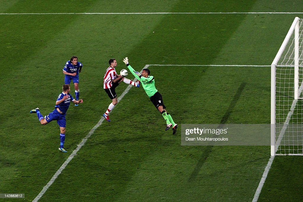 Goalkeeper Esteban Alvarado of AZ misses the ball as Tim Matavz of PSV shoots and scores with the final touch of the game to win the Eredivisie match...