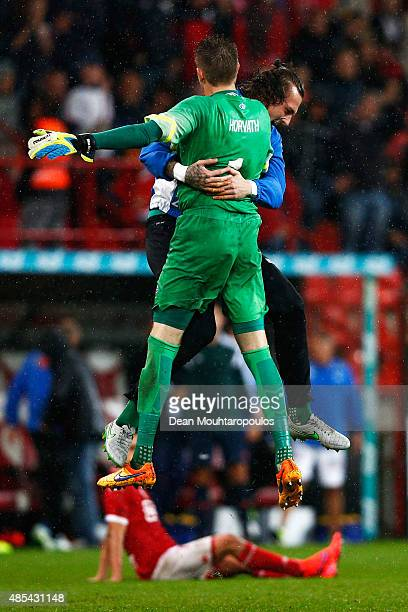 Goalkeeper Ethan Horvath of Molde FK celebrates with Andreas Linde after victory in the UEFA Europa League play off round second leg match between...