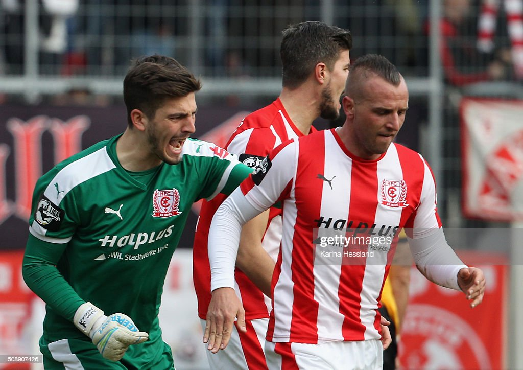 Goalkeeper Fabian Bredlow and Toni Lindenhahn of Halle looks happy during the Third League match between Hallescher FC and SG Dynamo Dresden at erdgas Sportpark on February 07, 2016 in Halle, Germany.