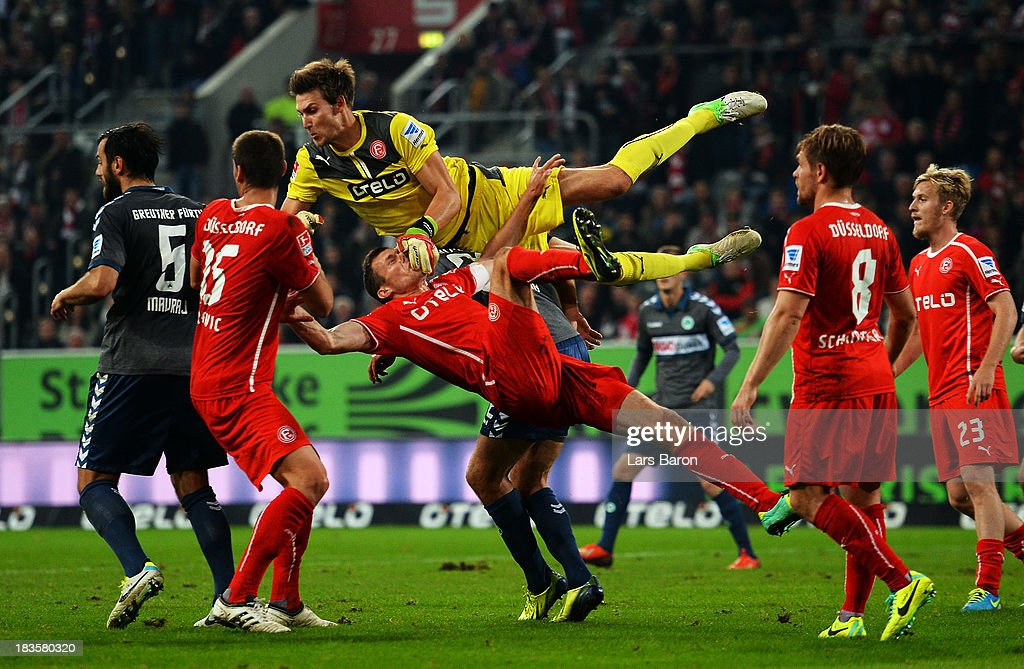 Goalkeeper Fabian Giefer of Duesseldorf jumps over team mate Oliver Fink during the Second Bundesliga match between Fortuna Duesseldorf and SpVgg Greuther Fuerth at Esprit-Arena on October 7, 2013 in Duesseldorf, Germany.