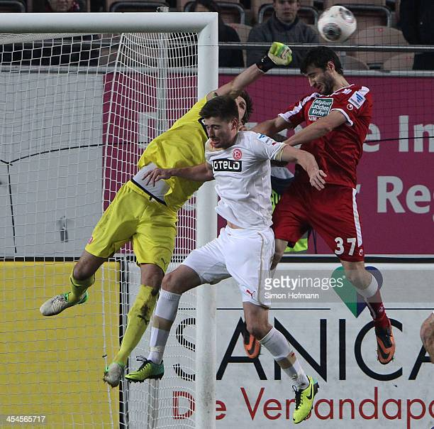 Goalkeeper Fabian Giefer of Duesseldorf makes a save against Markus Karl of Kaiserslautern during the Second Bundesliga match between 1 FC...