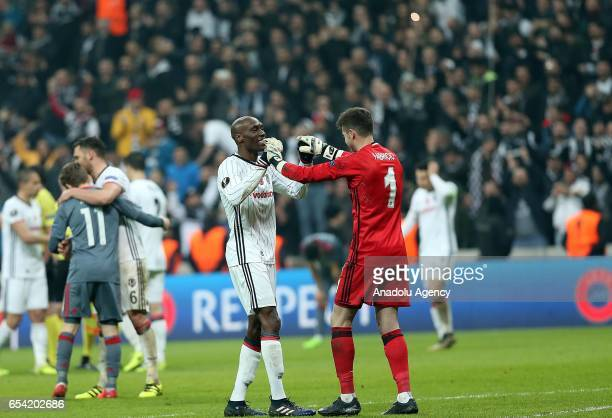 Goalkeeper Fabri and Talisca of Besiktas celebrate after winning the UEFA Europa League Round 16 secondleg match between Besiktas and Olympiacos at...