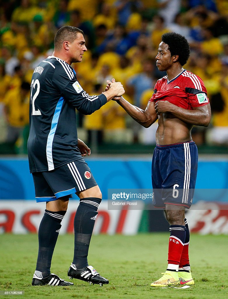 Goalkeeper <a gi-track='captionPersonalityLinkClicked' href=/galleries/search?phrase=Faryd+Mondragon&family=editorial&specificpeople=3449548 ng-click='$event.stopPropagation()'>Faryd Mondragon</a> and Carlos Sanchez of Colombia shake hands after a 2-1 defeat to Brazil in the 2014 FIFA World Cup Brazil Quarter Final match between Brazil and Colombia at Castelao on July 4, 2014 in Fortaleza, Brazil.