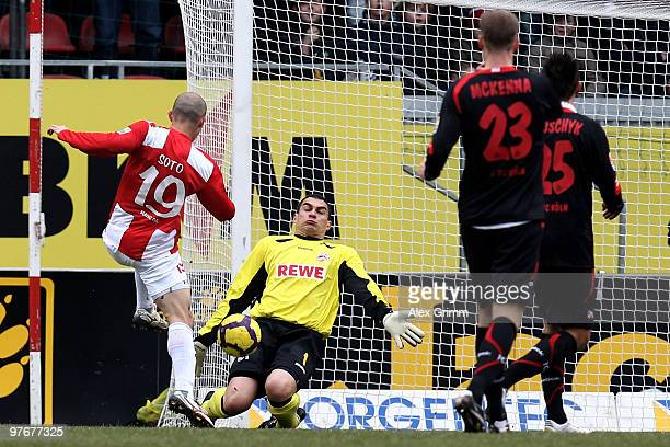 Goalkeeper Faryd Mondragon of Koeln makes a save against Elkin Soto of Mainz during the Bundesliga match between FSV Mainz 05 and 1 FC Koeln at the...