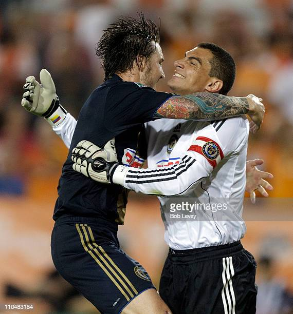 Goalkeeper Faryd Mondragon right receives congratulations from Danny Califf at the final whistle as they defeated the Houston Dynamo 10 at Robertson...
