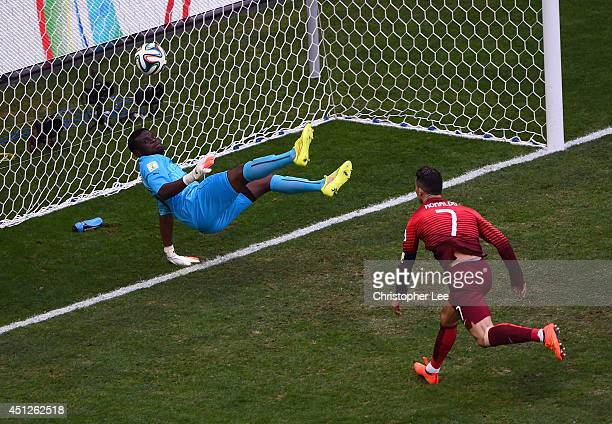 Goalkeeper Fatawu Dauda of Ghana makes a save at a header at goal by Cristiano Ronaldo of Portugal during the 2014 FIFA World Cup Brazil Group G...