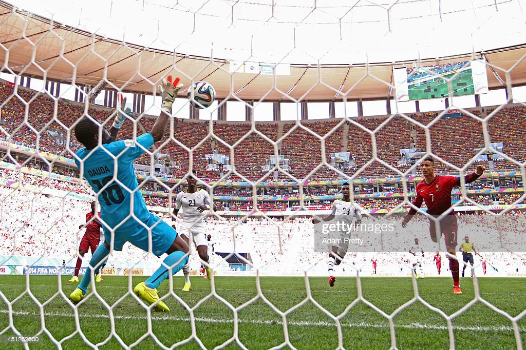 Goalkeeper Fatawu Dauda of Ghana makes a save at a header at goal by <a gi-track='captionPersonalityLinkClicked' href=/galleries/search?phrase=Cristiano+Ronaldo+-+Soccer+Player&family=editorial&specificpeople=162689 ng-click='$event.stopPropagation()'>Cristiano Ronaldo</a> of Portugal during the 2014 FIFA World Cup Brazil Group G match between Portugal and Ghana at Estadio Nacional on June 26, 2014 in Brasilia, Brazil.