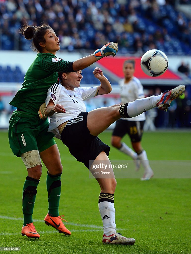 Goalkeeper Fatma Sahin of Turkey challenges <a gi-track='captionPersonalityLinkClicked' href=/galleries/search?phrase=Anja+Mittag&family=editorial&specificpeople=210615 ng-click='$event.stopPropagation()'>Anja Mittag</a> of Germany during the UEFA Womens Euro 2013 qualification match between Germany and Turkey at Schauinsland-Reisen-Arena on September 19, 2012 in Duisburg, Germany.