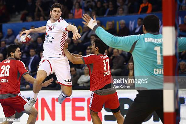 Goalkeeper Felipe Barrientos of Chile is challenged by Marko Mamic of Croatia during the 25th IHF Men's World Championship 2017 match between Croatia...