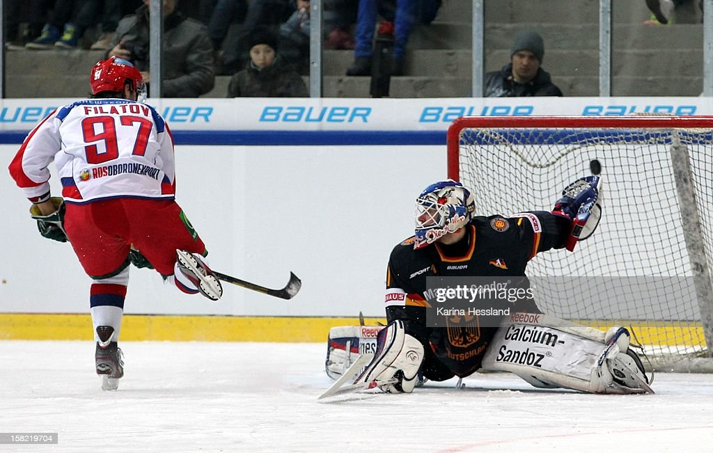 Goalkeeper Felix Brueckmann of Germany challenges Nikita Filatov of Russia on a penalty shoot during the Top Teams Sochi match between Germany and Russia at Kuechwaldhalle on December 11, 2012 in Chemnitz, Germany.