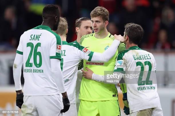 Goalkeeper Felix Wiedwald of Bremen celebrates with team mates after saving a penalty from Oemer Toprak of Leverkusen during the Bundesliga match...