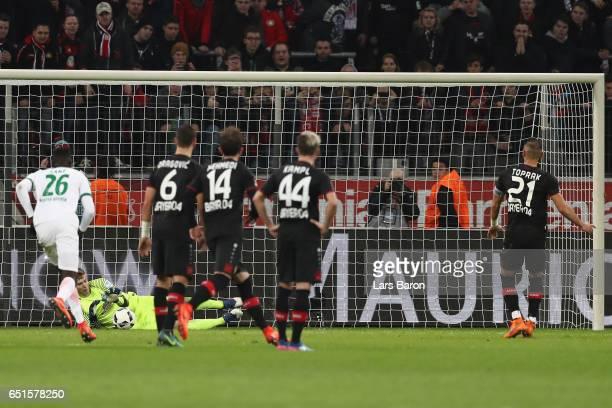 Goalkeeper Felix Wiedwald of Bremen saves a penalty from Oemer Toprak of Leverkusen during the Bundesliga match between Bayer 04 Leverkusen and...