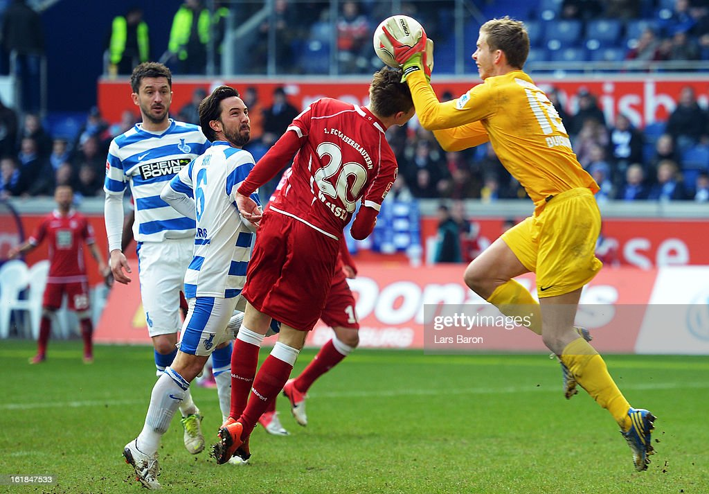 Goalkeeper Felix Wiedwald of Duisburg catches the ball next to Mitchell Weiser of Kaiserslautern during the Second Bundesliga match between MSV Duisburg and 1. FC Kaiserslautern at Schauinsland-Reisen-Arena on February 17, 2013 in Duisburg, Germany.