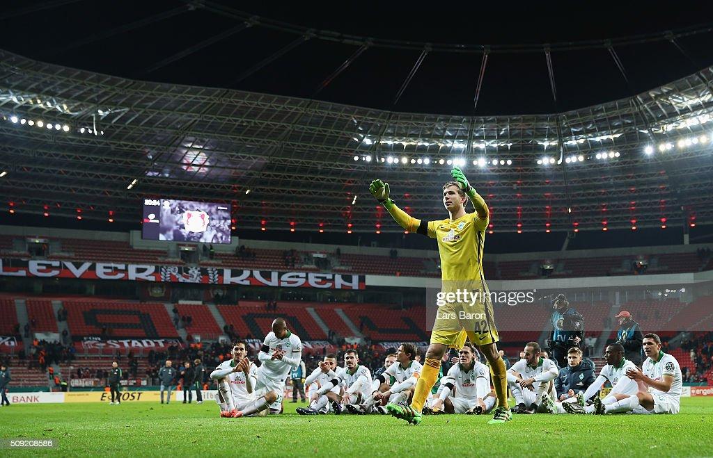Goalkeeper Felix Wiedwald of Werder Bremen celebrates victory with team mates after the DFB Cup Quarter Final match between Bayer Leverkusen and...
