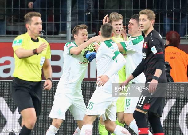 Goalkeeper Felix Wiedwald of Werder Bremen holds the penalty of Oemer Toprak of Leverkusen during the Bundesliga soccer match between Bayer...