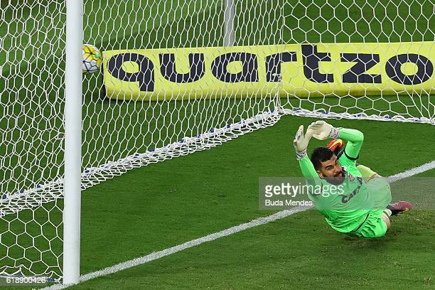 Goalkeeper Fernando Miguel of Vitoria tries to defend shot by Richarlison of Fluminense during a match between Fluminense and Vitoria as part of...