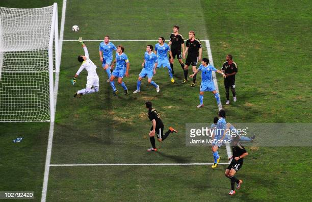Goalkeeper Fernando Muslera of Uruguay saves a goal scoring chance during the 2010 FIFA World Cup South Africa Third Place Playoff match between...