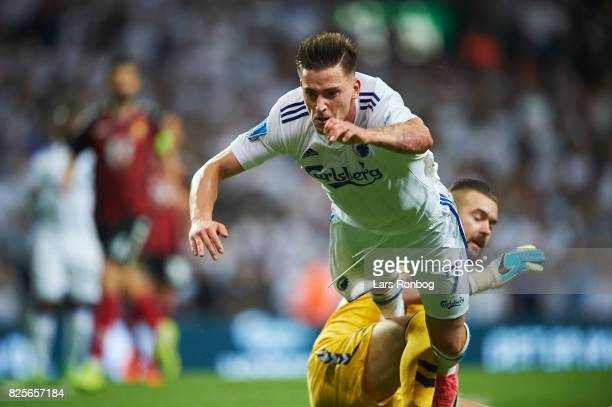 Goalkeeper Filip Gacevski of FK Vardar Skopje tackle Benjamin Verbic of FC Copenhagen for a penalty during the UEFA Champions League Qualification...