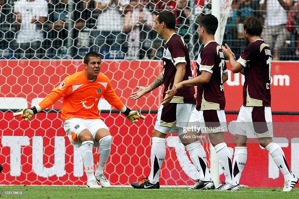 Goalkeeper Florian Fromlowitz of Hannover shouts to team mates Emanuel Pogatetz Moritz Stoppelkamp and Christian Schulz during the preseason friendly...