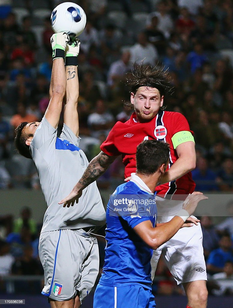 Goalkeeper Francesco Bardi of Italy clears the ball ahead of Stefan Strandberg of Norway during the UEFA European U21 Championship Group A match between Norway and Italy at Bloomfield Stadium on June 11, 2013 in Tel Aviv, Israel.