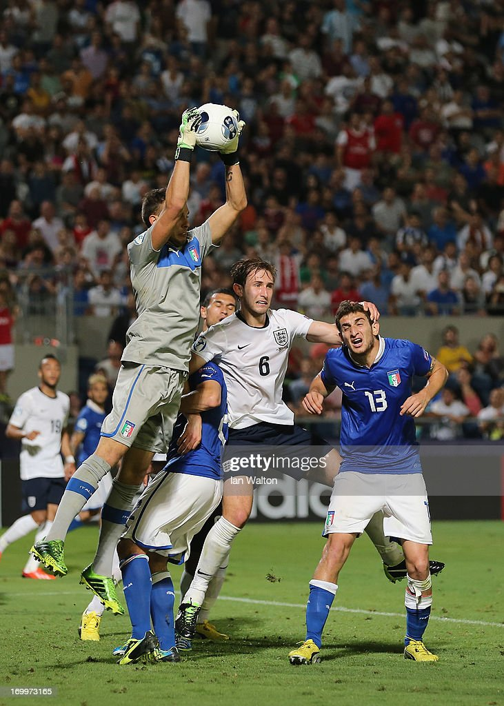 Goalkeeper Francesco Bardi of Italy clears the ball from Craig Dawson (C) of England during the UEFA European U21 Championships, Group A match between England and Italy at the Bloomfield Stadium on June 5, 2013 in Tel Aviv, Israel.