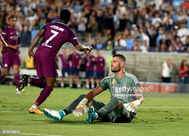 Goalkeeper Francisco Casilla of Real Madrid reacts after Raheem Sterling of Manchester City scored a goal during the second half of the International...