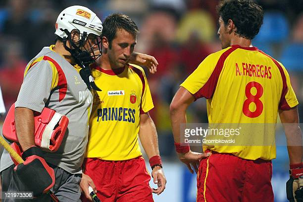 Goalkeeper Francisco Cortes of Spain and team mates Roc Oliva and Alex Fabregas look dejected during the Men´s EuroHockey Championships 2011 Pool A...
