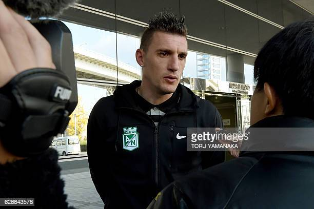 Goalkeeper Franco Armani of Colombian football club Atletico Nacional answers questions upon their arrival at Kansai Airport in Izumisano Osaka...