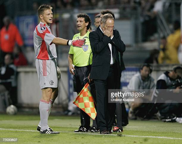Goalkeeper Frank Rost of Schalke comforts manager Andreas Mueller during the UEFA Cup second leg match between AS Nancy and Schalke 04 at the Marcel...