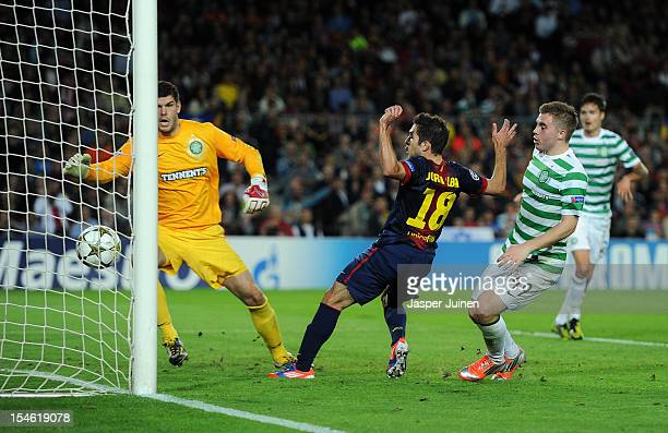 Goalkeeper Fraser Forster and James Forrest of Celtic FC watch as Jordi Alba of Barcelona scores the winning goal in overtime during the UEFA...