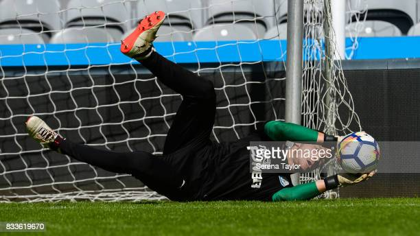 Goalkeeper Freddie Woodman dives for the ball during a Newcastle United Open Training session at StJames' Park on August 17 in Newcastle upon Tyne...