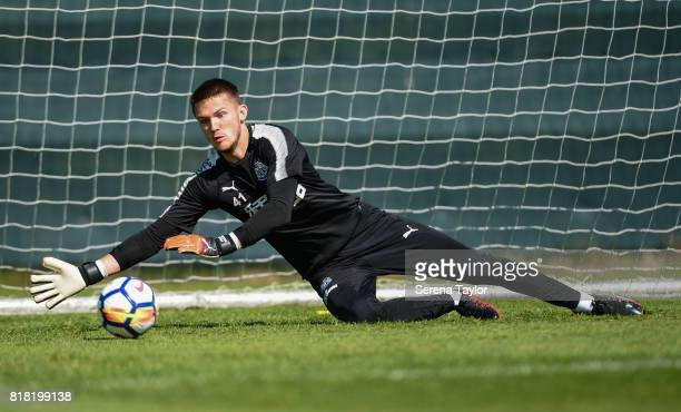 Goalkeeper Freddie Woodman dives to make a save during the Newcastle United Training session at Carton House on July 18 in Maynooth Ireland