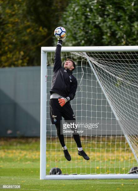 Goalkeeper Freddie Woodman jumps in the air to catch the ball during the Newcastle United Training session at the Newcastle United Training Centre on...