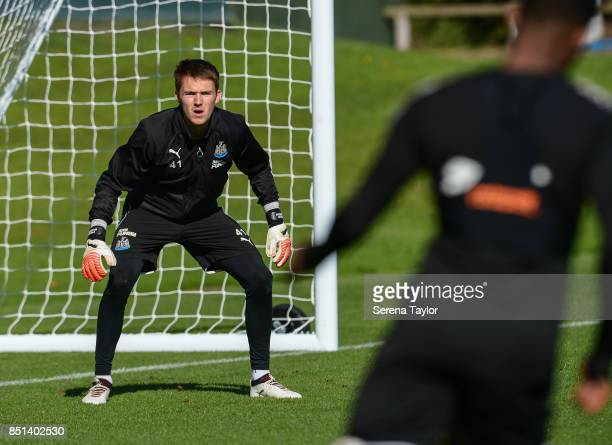 Goalkeeper Freddie Woodman looks to saves the ball during the Newcastle United Training session at the Newcastle United Training Centre on September...
