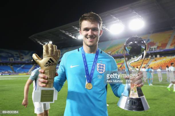 Goalkeeper Freddie Woodman of England celebrates victory with the Golden Glove Award and World Cup trophy after the FIFA U20 World Cup Korea Republic...